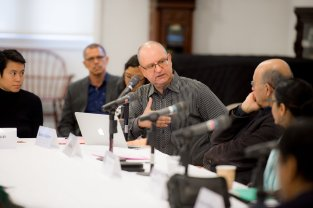 Director of Brown's Middle East Studies program Professor Beshara Doumani asks a question during the first panel