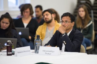 Mellon Sawyer Postdoctoral Research Associate Vikramaditya Thakur listens during the first panel of the seminar