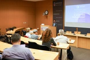 Mellon Sawyer Postdoctoral Research Associate Vikramaditya Thakur addresses the audience